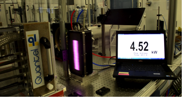 Figure 1. the diode array for the giga-shot optical laser demonstrator in operation. the pump light illuminates a power meter (violet beam), which reads an average power (4.52 kw) corresponding to 126-kw peak power for the experimental duty cycle.