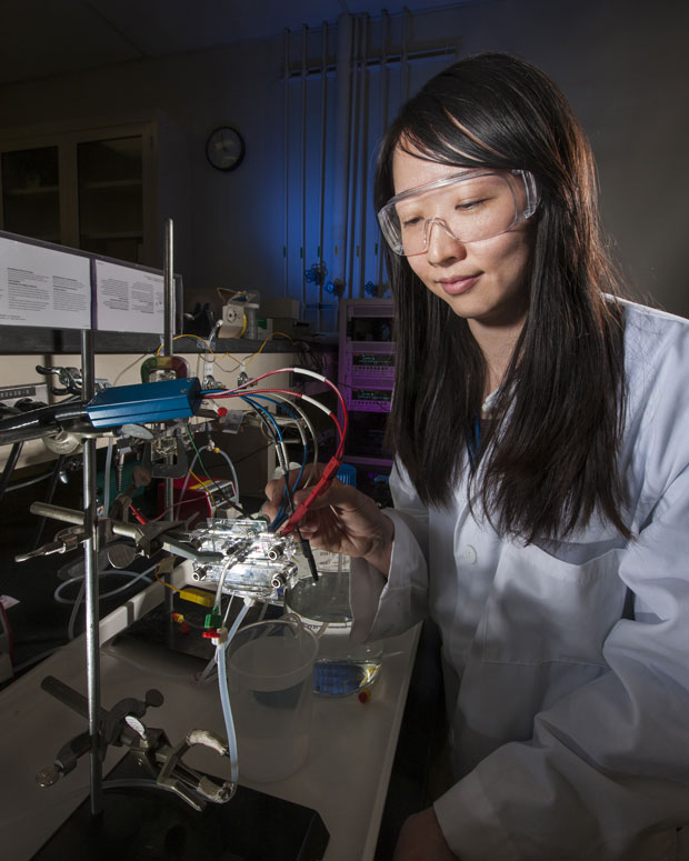 This researcher is working with a flow-through electrode capacitive desalination setup. small cells are used to study the impact of operational parameters, such as charging rate or flow rate, on the device performance and to identify energy loss mechanisms. this information will be used to determine the optimal operating conditions for larger devices.