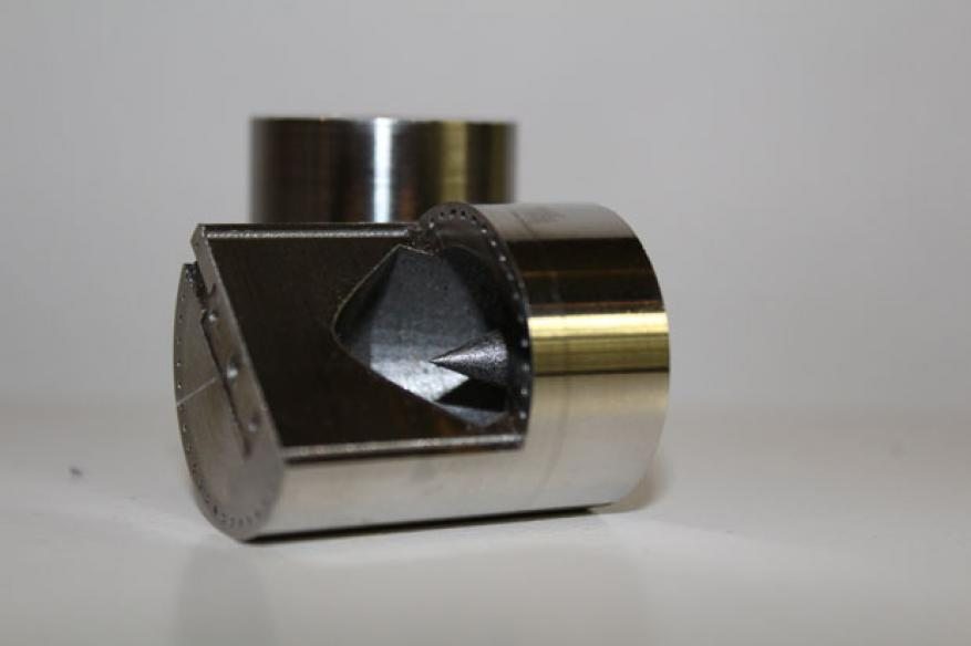 Cross-section of a superconducting resonance cavity with optimized internal geometry. created by leveraging livermore metal additive manufacturing capabilities, these devices were employed to systematically study and reduce quantum decoherence.