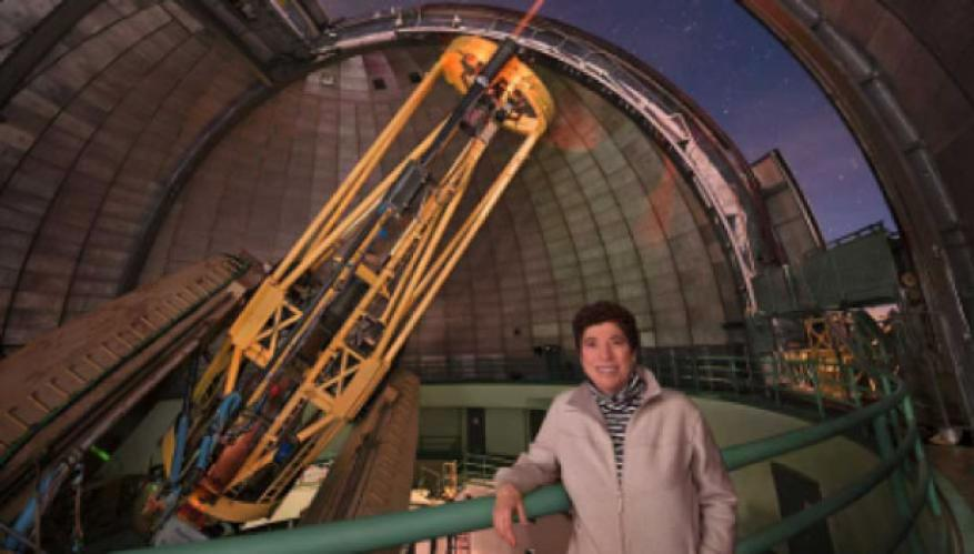 Claire max, in front of the adaptive optics system at the lick observatory, is a leader in making near-diffraction-limited imaging possible on large ground-based telescopes. photo courtesy of laurie hatch.